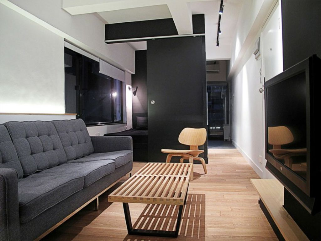 Minimalist Narrow Living Room With Black And White Color Schemes