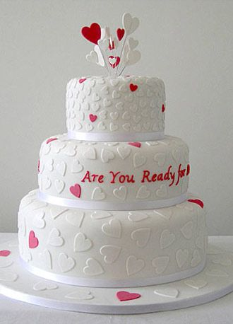 heart wedding cake tell your loved one theyre lovely with this cheeky pink and white love heart wedding cake design for flavours please see fillings