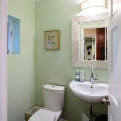 Powder room design pedestal sink Pottery Barn mirror small space