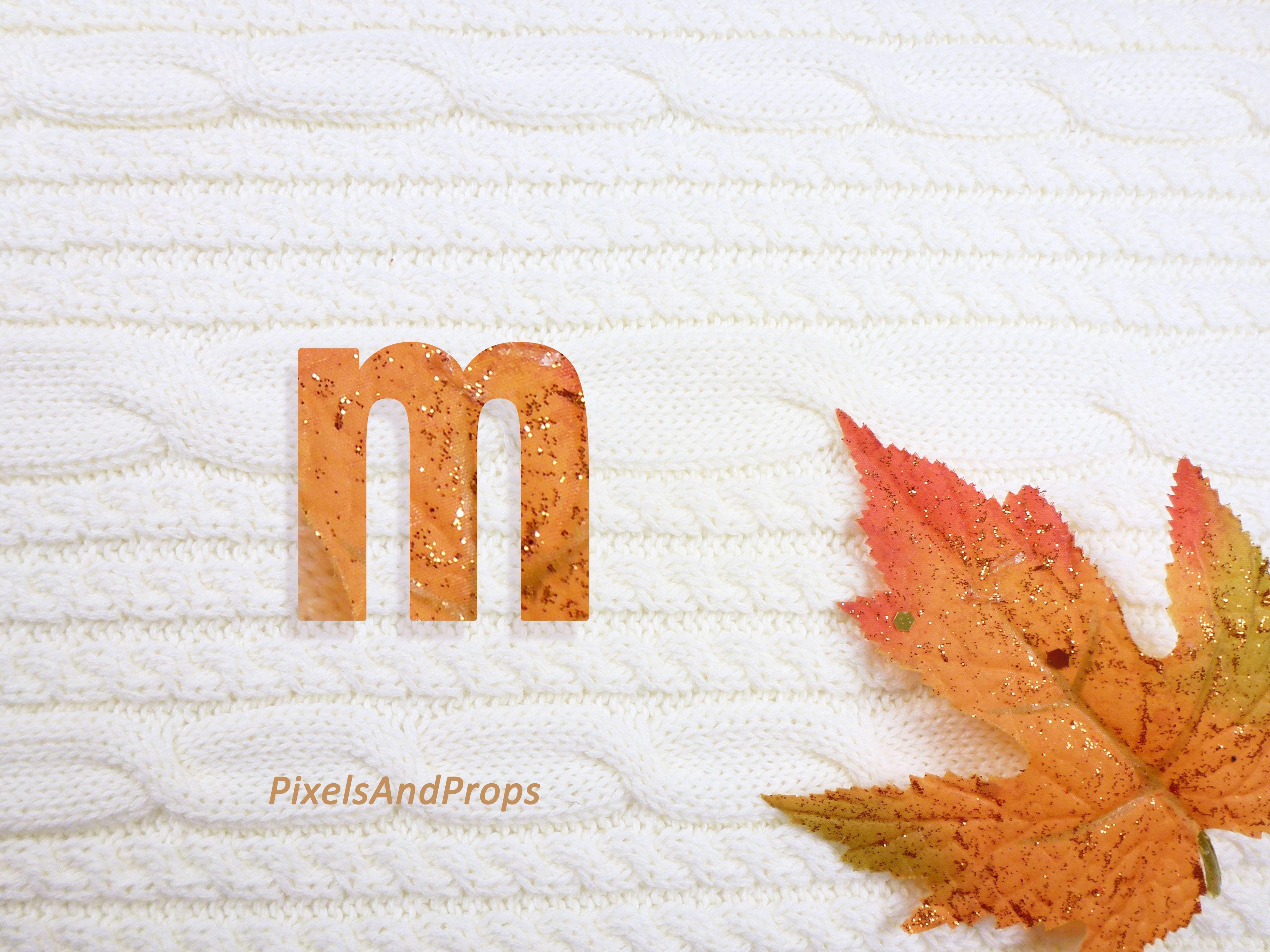 Lowercase letter m with glitter leaf and sweater knit. #fall #autumn #alphabet #typography #initial #monogram #font   maple leaf