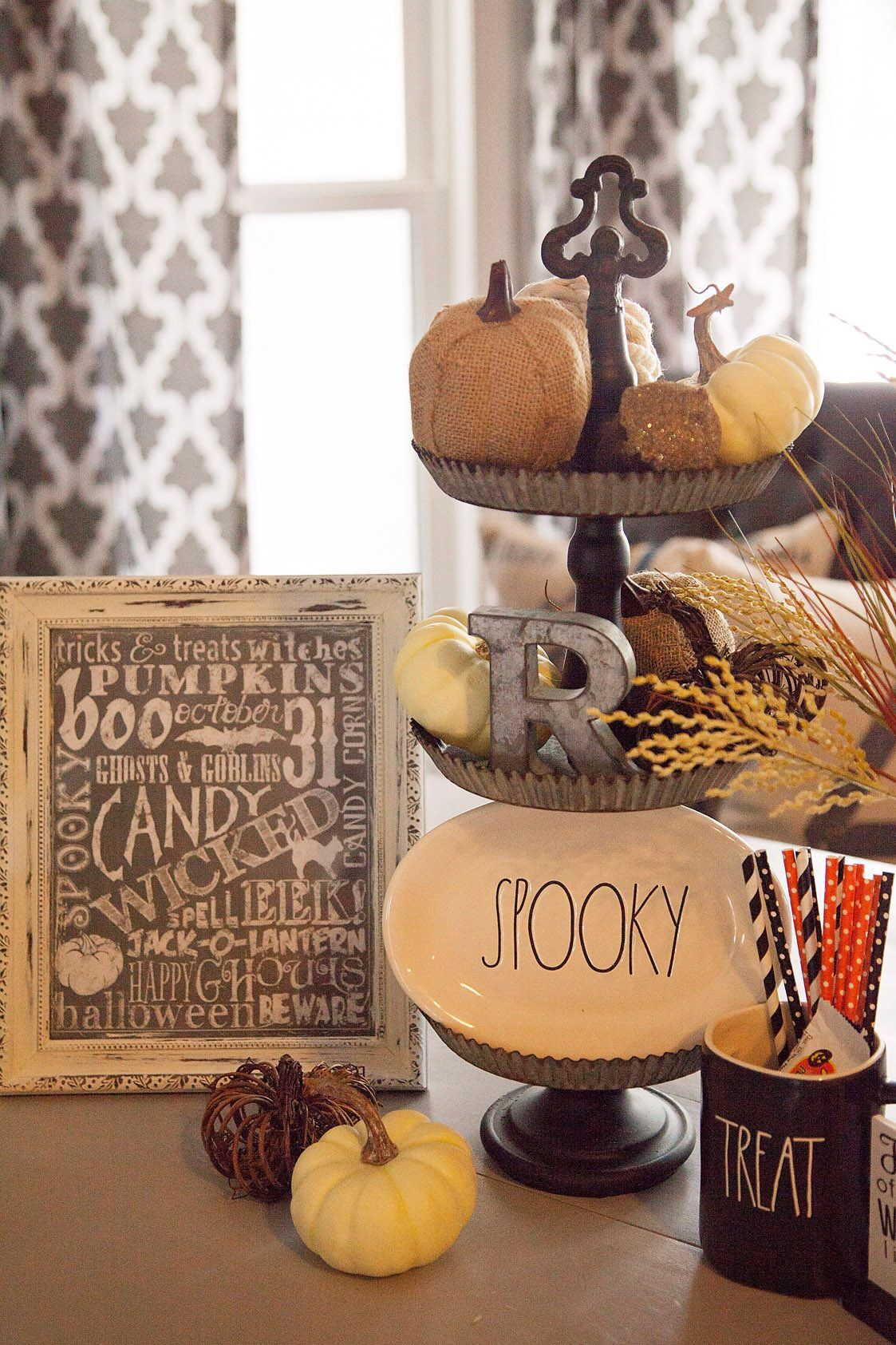 Farmhouse fall or halloween vignette with tier tray and rae dunn