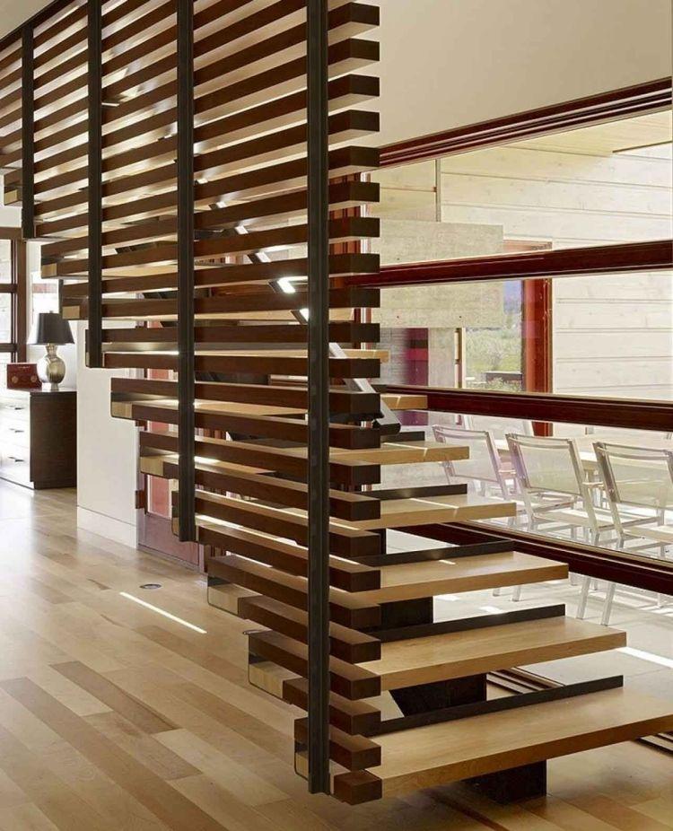 Escalier en bois et acier à limon central et garde corps de design moderne