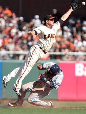 San Francisco Giants second baseman Ryan Theriot is unable to make the catch as San Diego Padres' Everth Cabrera steals second base