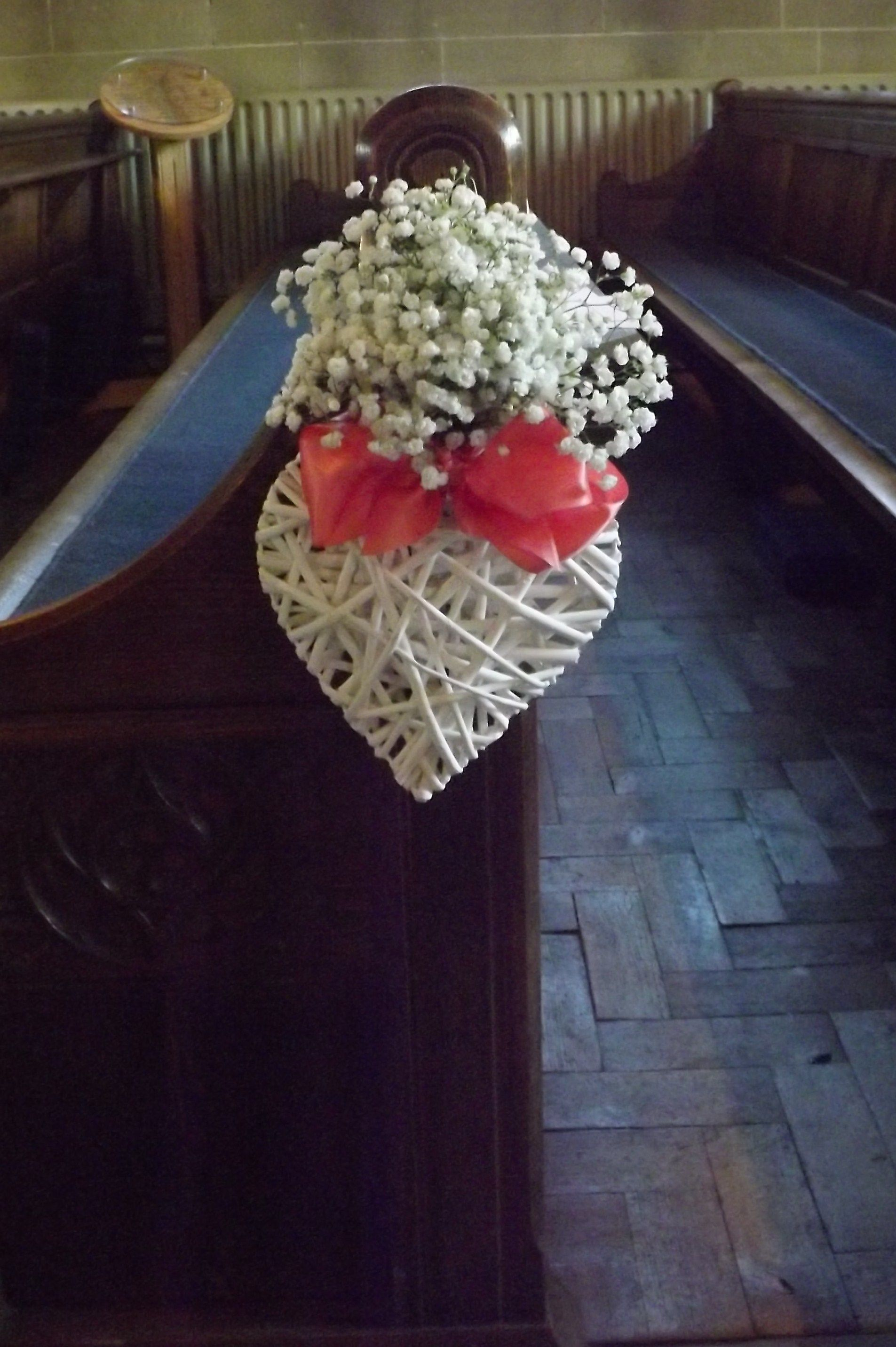 church pew ends of hearts with gypsophilia www.weddingflowersbylaura.com