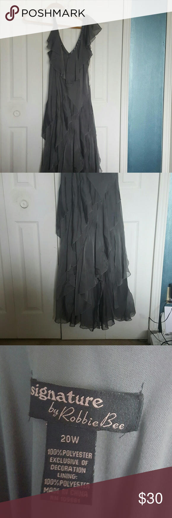 Long grey dress Long grey dress with beading accents around the shoulders and neck. Layered thoughout the dress so it hides all the problem areas. V neck both front and back signature Dresses Maxi