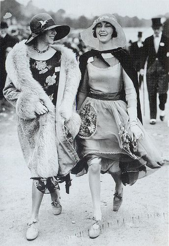 """""""At Ascot in 1928 the woman on the right has chosen to wear a softer, more elegant dress with sheer and floral detailing similar to the picture dresses fashionable at the beginning of the Twenties. Her wide straw hat is more suited to this look than a sleek cloche might be."""""""