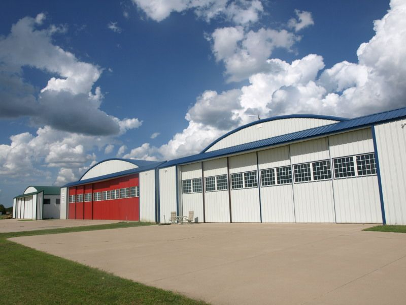 Texas Airpark With Grass Runway, Restricted Hangar Design And Hangar Homes