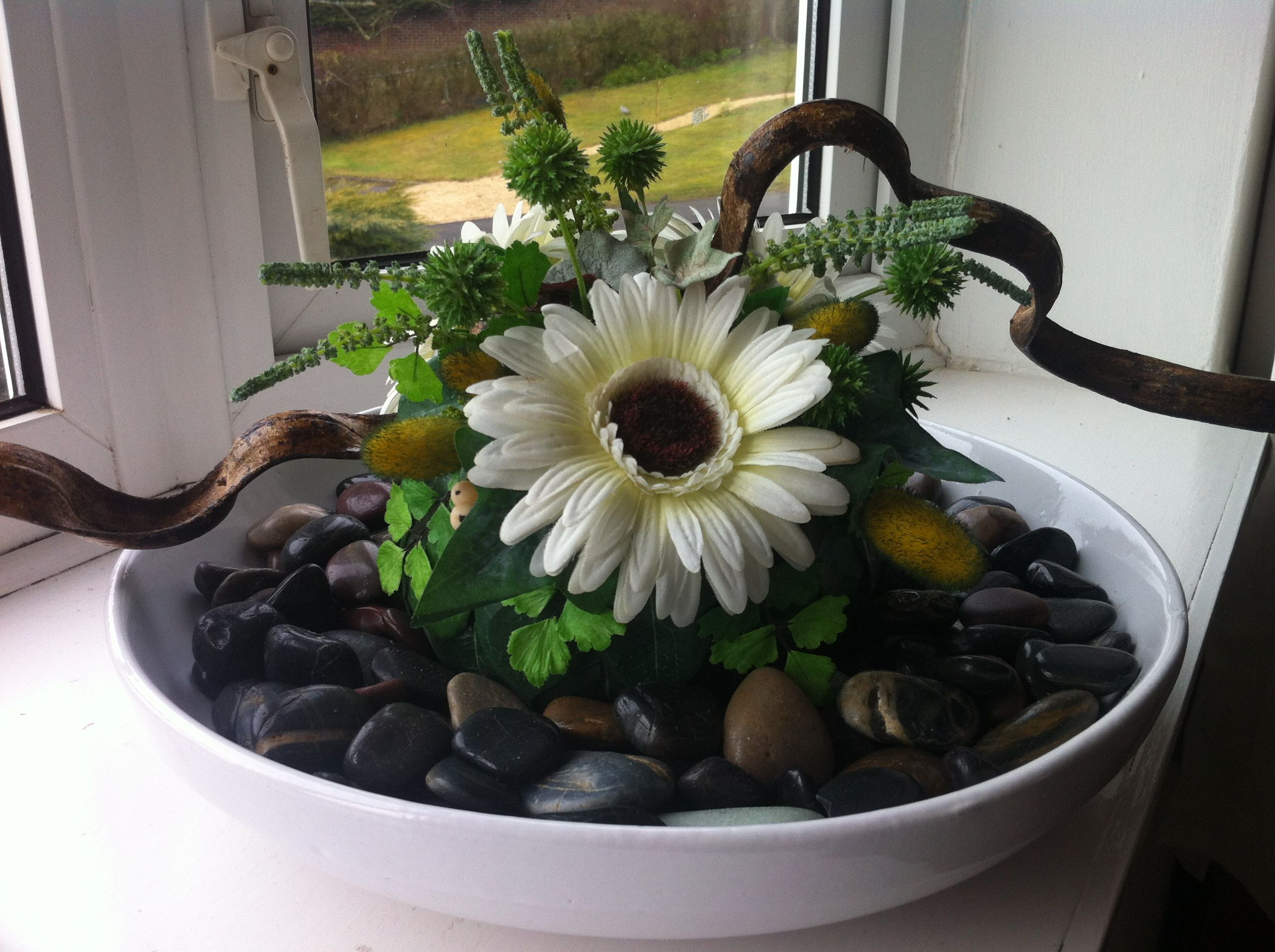 Unusual posy for a bedroom bow windowsill.