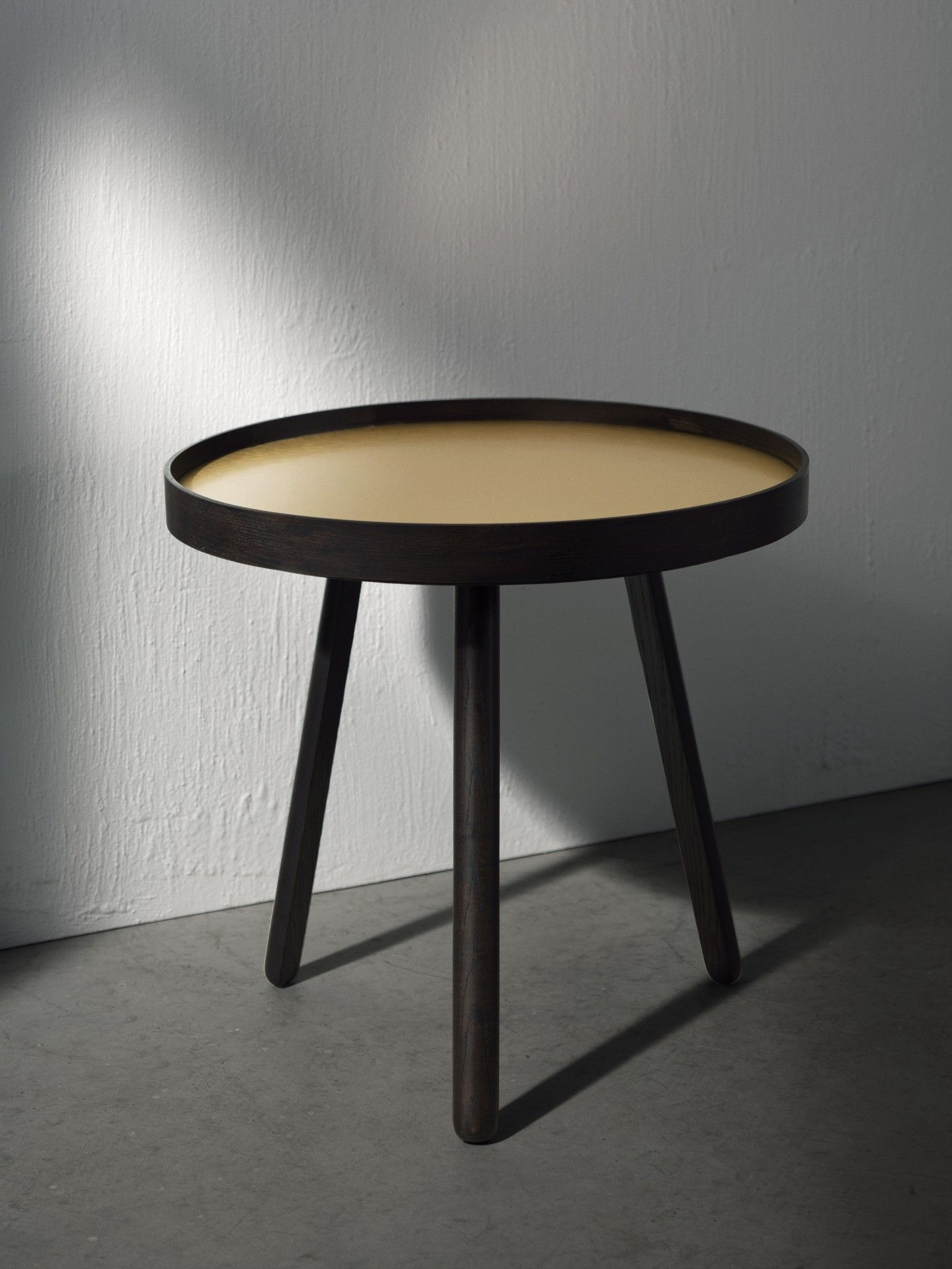 Beautiful in its simplicity Uncover is a small side table with a