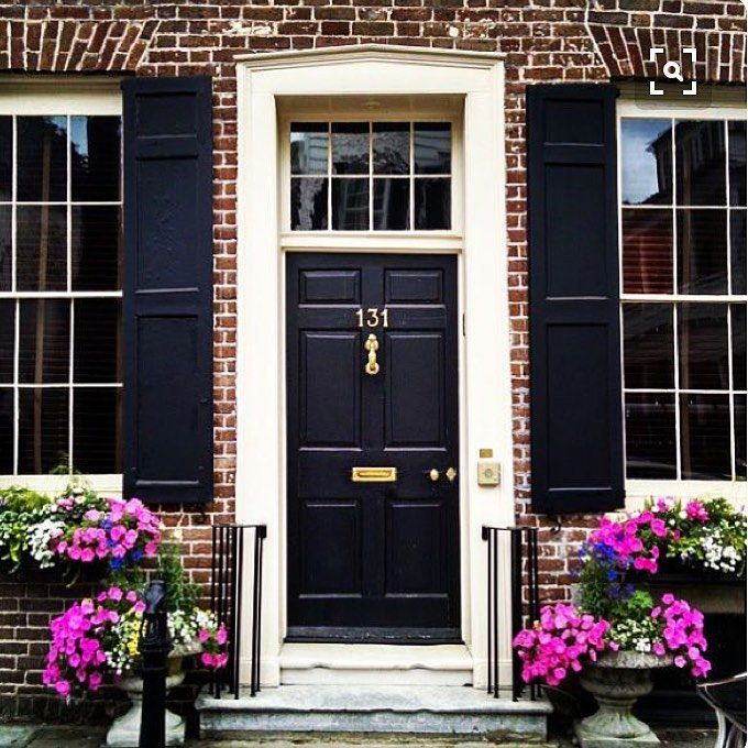 Beautiful brick house with a black front door and shutters and white ...