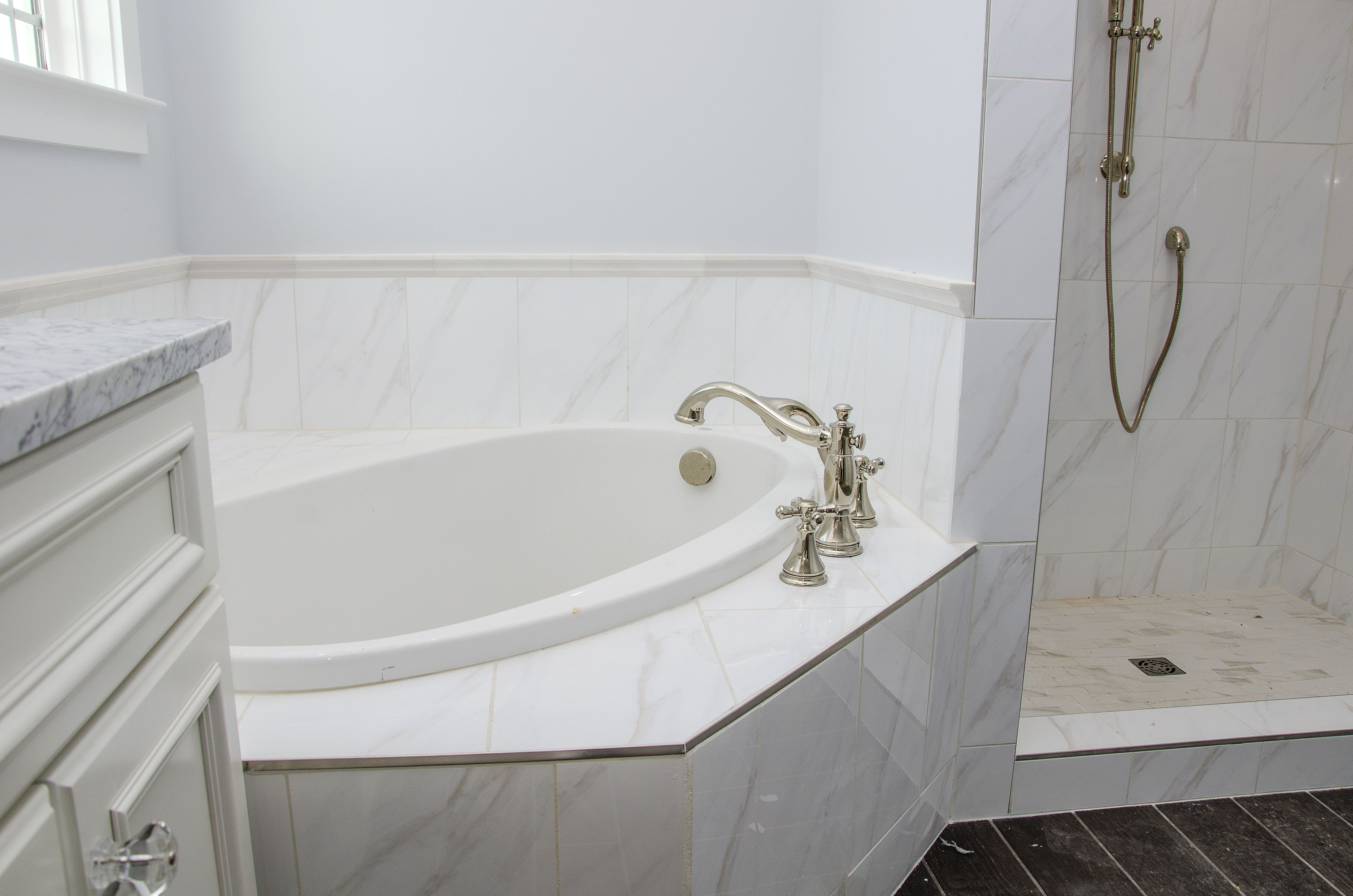 This custom bathroom is ultra relaxing with its separate soaker tub ...