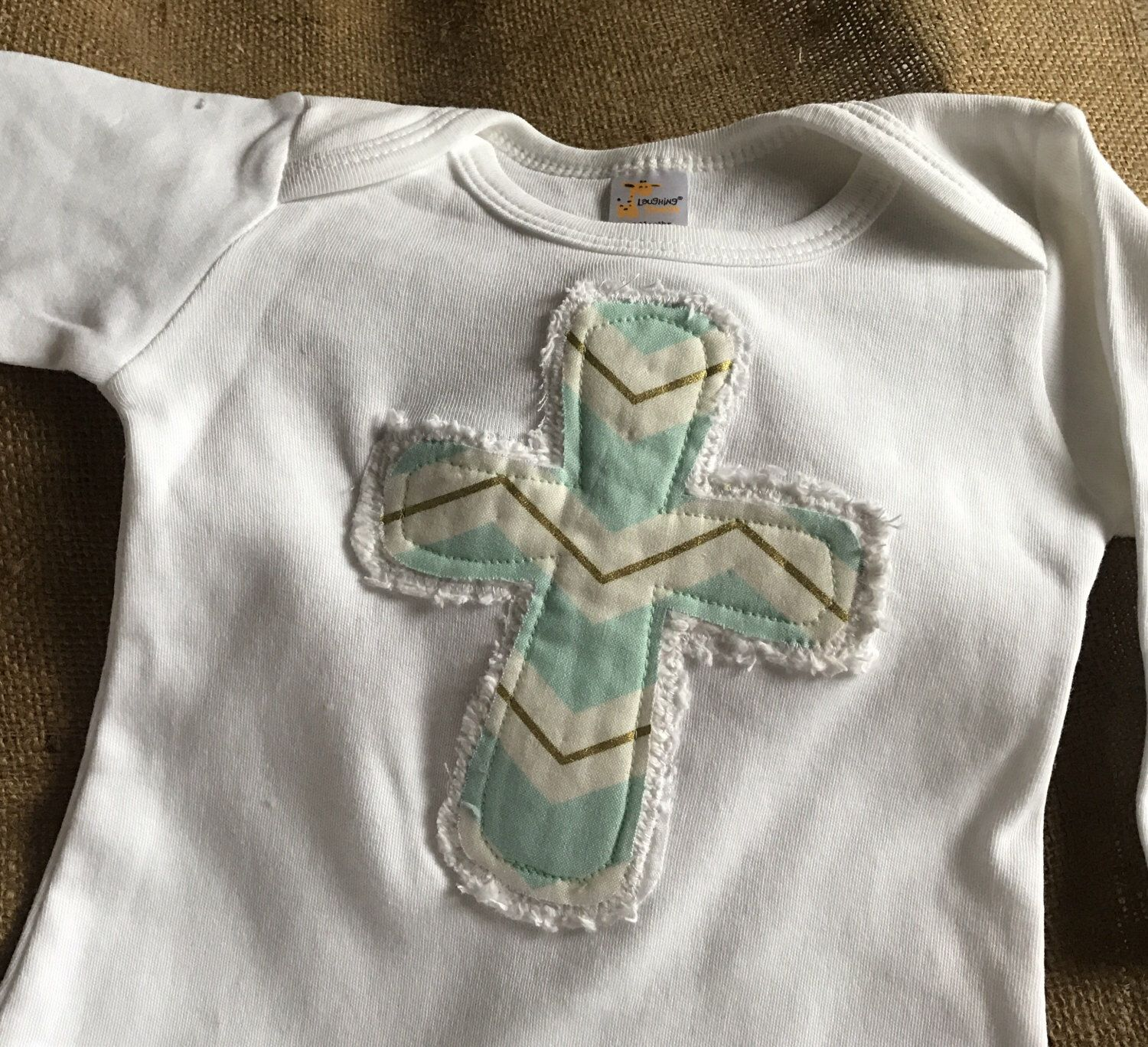 A personal favorite from my Etsy shop https://www.etsy.com/listing/497009786/applique-cross-infant-gown-or-one-piece