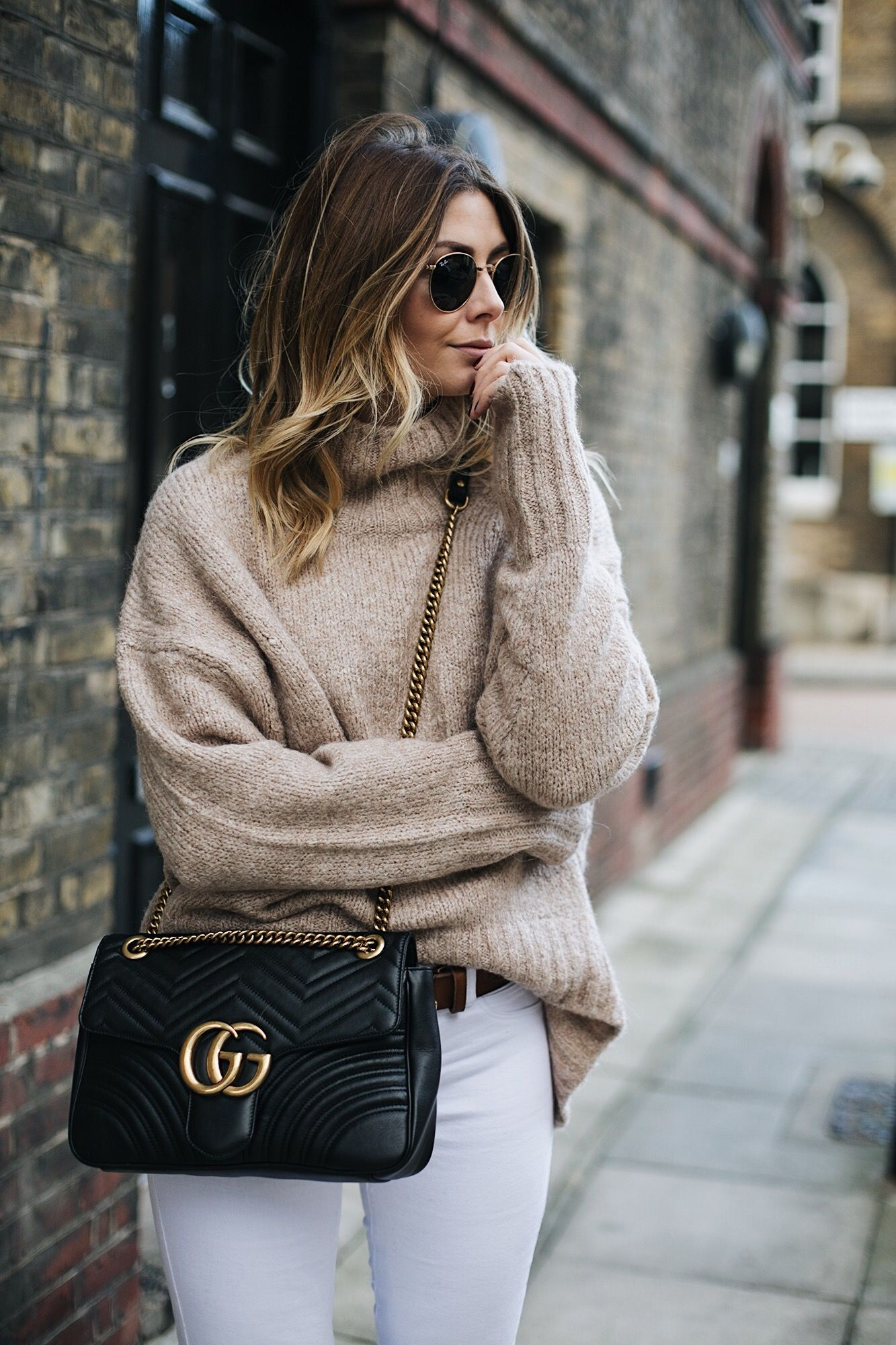 e800067fc Emma Hill wears Beige chunky sweater, white skinny jeans medium black  leather Gucci Marmont Matelasse bag, tan belt, Round gold metal frame  Rayban ...