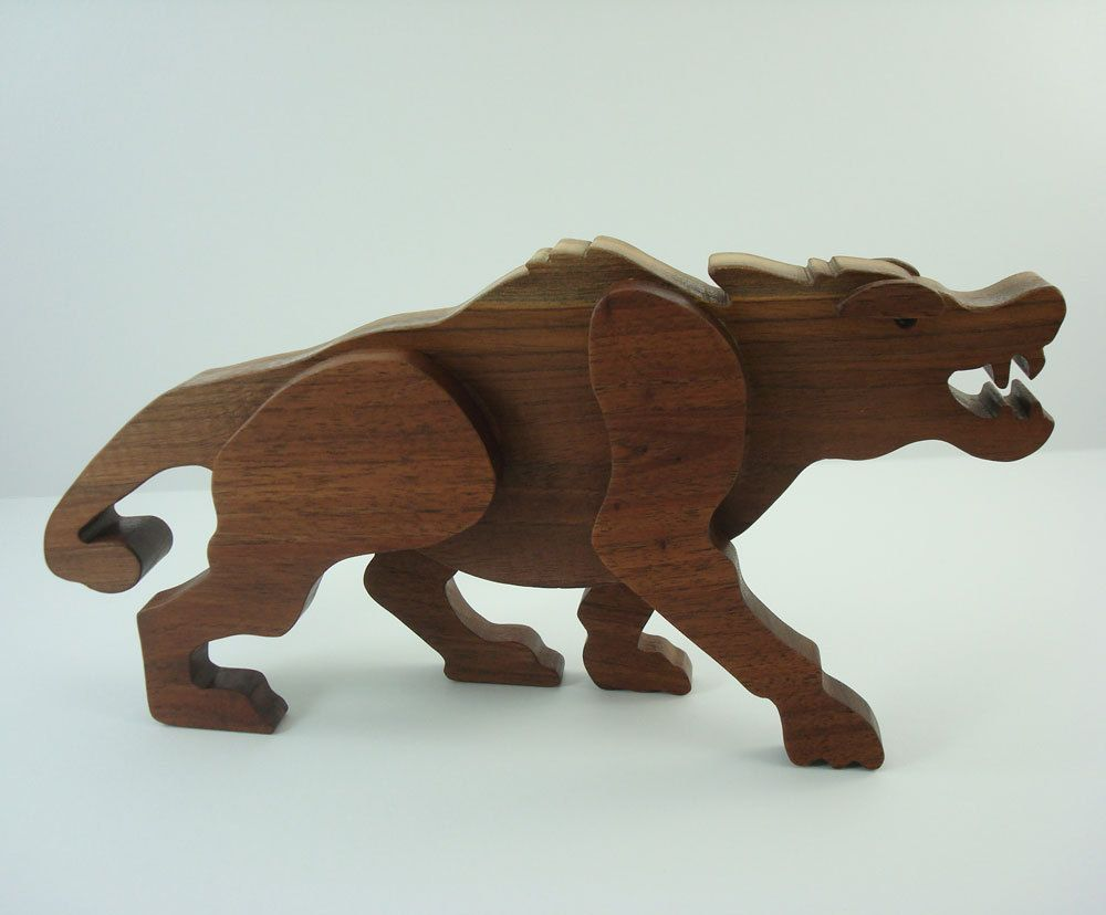 Step by step demonstration showing how to make a wood toy Andrewsarchus out of walnut using a scroll saw. The pattern for the Andrewsarchus is from the book Scroll Saw Patterns for Toy Dinosaurs and Prehistoric Creatures by John and Cynthia Lewman. It is available for purchase on their website at www.toymakerpress.com.