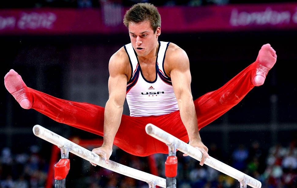 Team USA's Sam Mikulak competes on the parallel bars during the men's Olympic gymnastics team final in London.