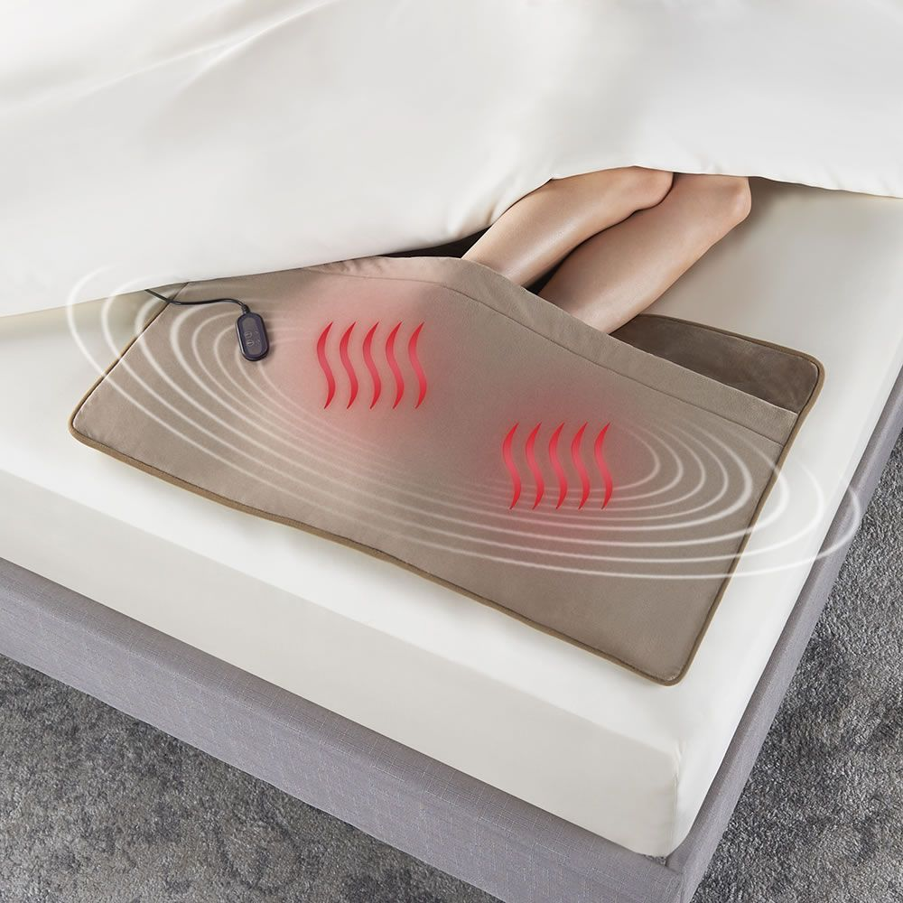 The Massaging Foot Of The Bed Warmer Hammacher Schlemmer