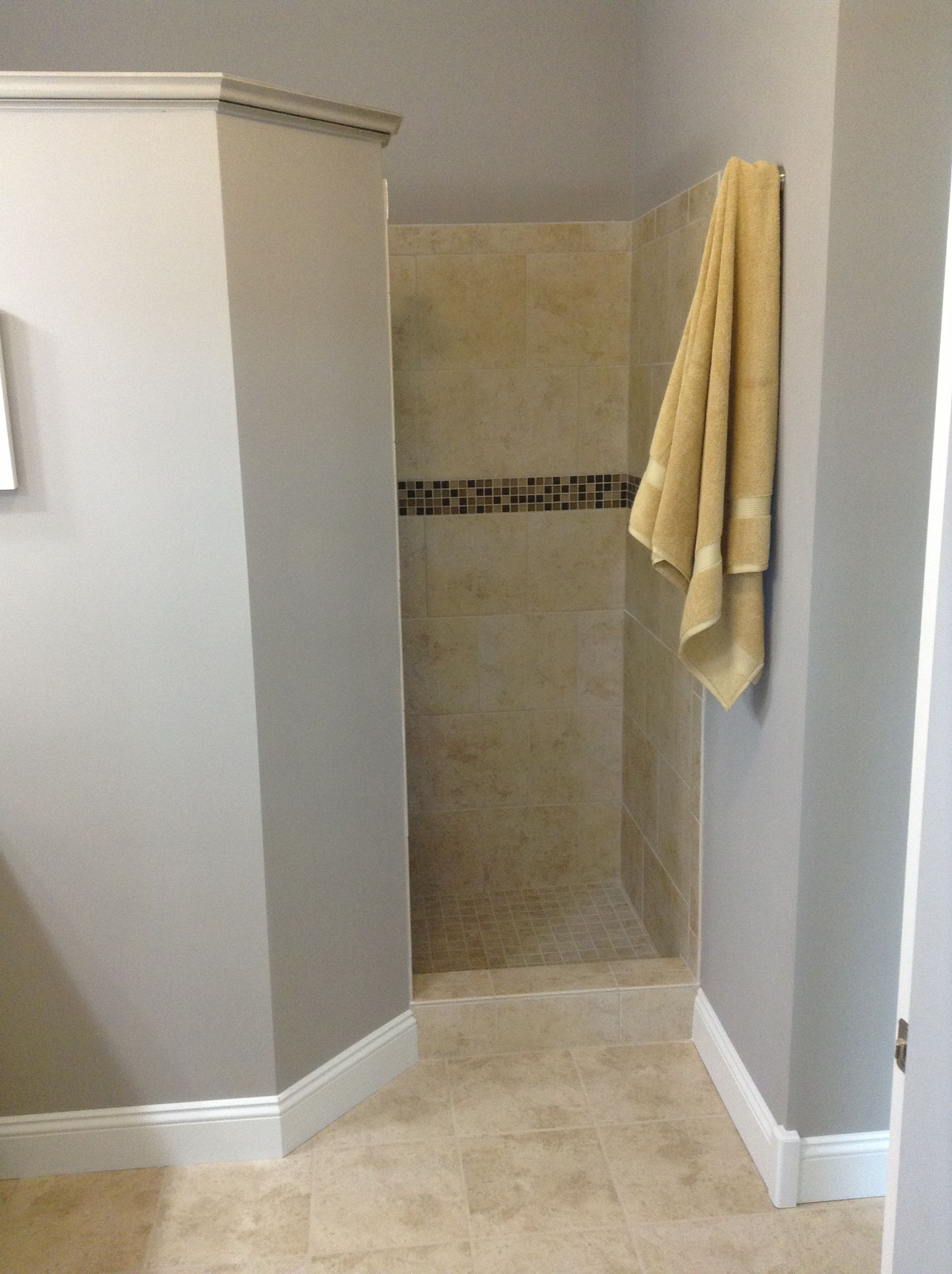 With this walk-in shower, you'll never clean a shower door again ...