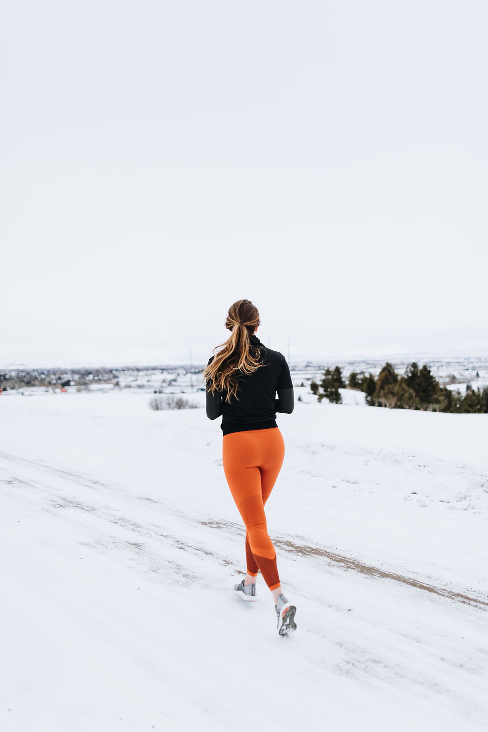 cold weather runs in adidas orange warp knit tights for a