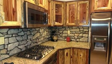 design counter and cabinets donu0027t line up backsplash | Rustic Red Cedar Kitchen with cultured Stone Backsplash rustic-kitchen & design counter and cabinets donu0027t line up backsplash | Rustic Red ...