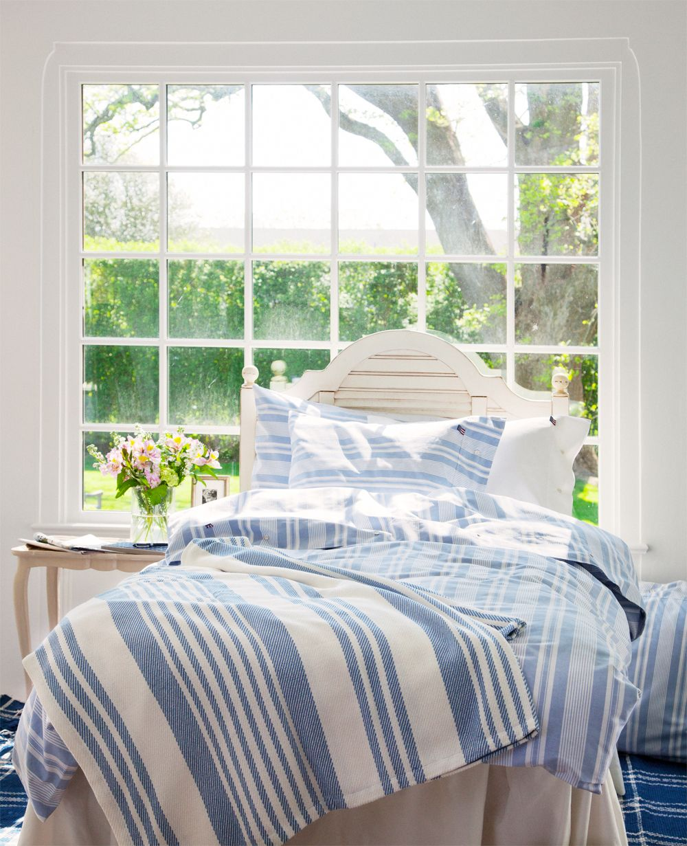 love that big window and the stripe blankets/linens Blue