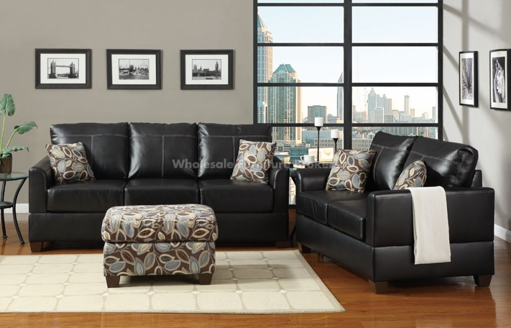 Living Room Furniture With Gray Walls grey walls, light colored laminate floors, dark leather couches