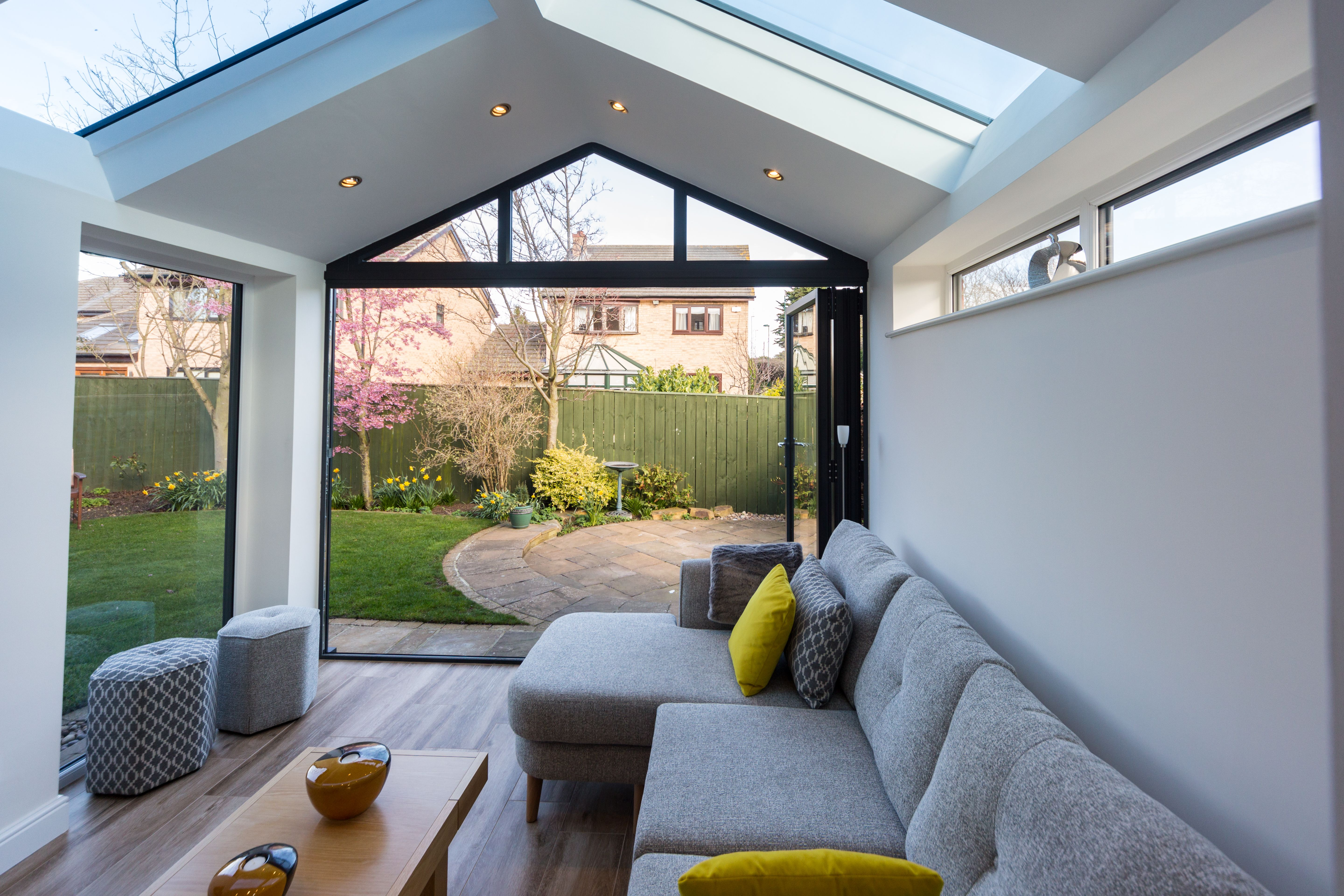 This beautiful Ultraroof house extension features full length glass panels in the roof and stunning bi-fold doors that lead out into the garden.