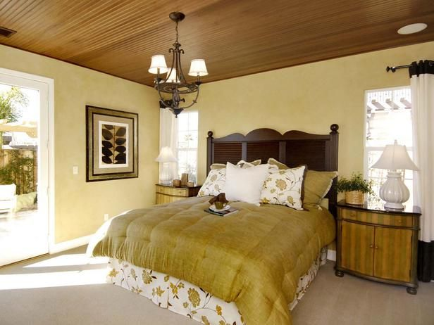 Green Guest Bedroom A beamed ceiling infuses warmth into this