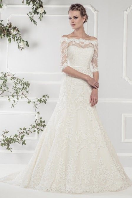 768ea967fd6 Romantic A line gown crafted with delicate lace over satin. Floor-sweeping  lace with very flattering off-shoulder lace sleeve style and lace detailed  low ...