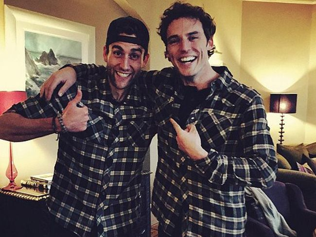 Me Before You stars, Sam Claflin and Matthew Lewis (Will and Patrick) hand out on set.