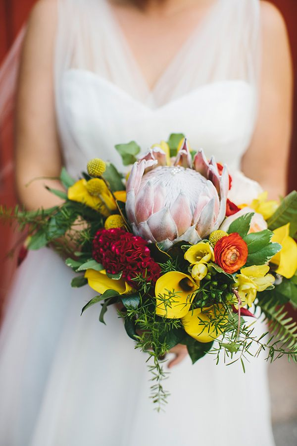 protea bouquet with yellow calla lilies - photo by Readyluck Studios http://ruffledblog.com/industrial-wedding-at-a-metalworking-studio