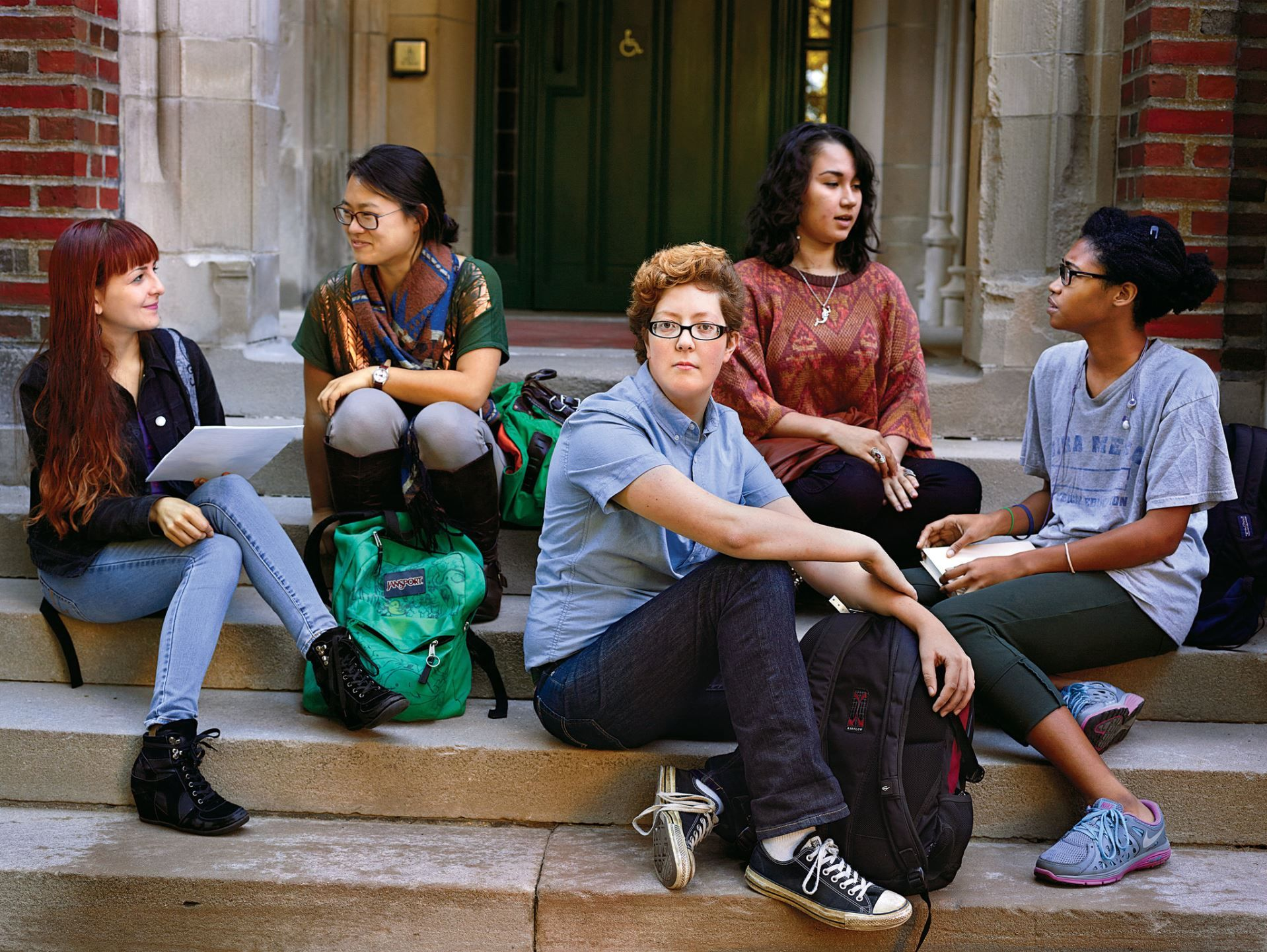 Timothy Boatwright (center), a trans man, with his Wellesley classmates. - Martin Schoeller for The New York Times