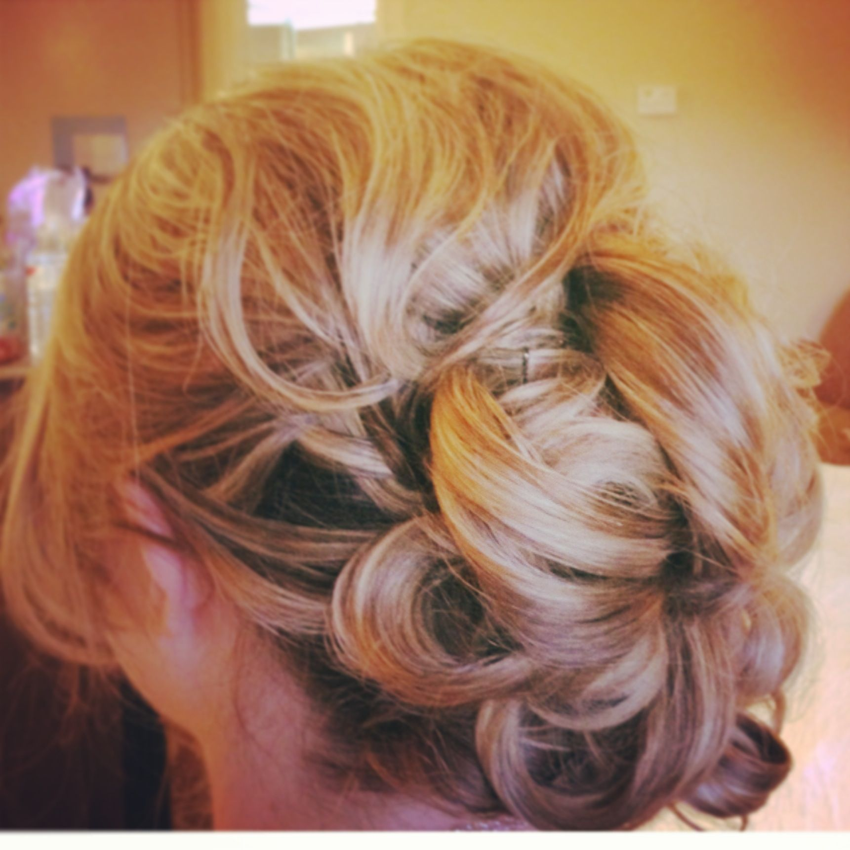 Soft Romantic Curls In A Half Up Style: Romantic Loose Curls Pinned Up With Soft Side Swept Bangs