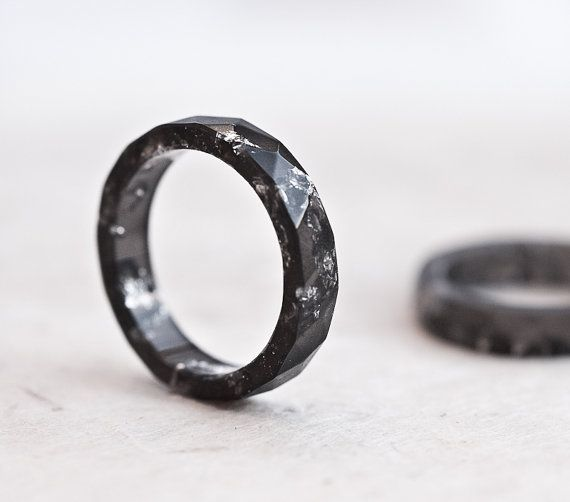 This small subtle black faceted ring is made from bio based eco-resin. The ring contains sparkled silver flakes.  This resin ring is stackable. My resin jewellery is cast in handmade by me silicone molds, hand sanded and hand polished. Minor imperfections may result such as tiny bubbles. Each ring is unique and slightly different, please keep in mind that yours won't be identical to the photo but very similar. Available sizes (US):  4, 4 1/2, 5, 6, 6 1/2, 7, 7 1/2, 8 1/2 Height approx.: 4-5mm Don't know your ring size? Go here: http://bit.ly/rn2lJ ***This listing is for ONE black ring with silver flakes*** Similar big sized black resin ring with silver flakes: https://www.etsy.com/listing/188462026/black-resin-ring-men-ring-silver-flakes Please note that due to monitor differences, colors may vary slightly. See all my handmade items from resin: http://www.etsy.com/shop/daimblond/search?search_query=resin&search_submit=&search_type=user_shop_ttt_id_5563489&shopname=daimblond&langid_override=-1 ♥ Thank you for looking! ♥ ♥♥♥♥♥♥♥♥ Enter my shop here: http://www.etsy.com/shop.php?user_id=5562123 All of my designs are handmade and should be treated with care. I only use eco-friendly epoxy resin which is durable and long-lasting material. Proper cleaning and maintenance is essential to the longevity of your ring.  It normally shows no signs of wear/tear if treated properly.  I offer a high quality product that will last several years. However, certain rings (especially once with a thin band) are fragile and need to be treated with care. A ring can crack if knocked against a hard surface. The surface of a ring is highly polished and may be scratched if in contact with abrasives. Using abrasive cleaners or scrubbing pads will dull the surface of the ring.  It is recommended to take off a ring while washing your hands and avoid contact with products containing alcohol and /or chemicals (including hand sanitizers). Finally keep your ring away from direct sunlight to maintain its original color. Getting the Correct Ring Finger Size Resin rings are a little bit wider and don't slide easily onto the finger as the other thin metal rings. For a comfort fit, I recommend to order about half to one full size larger if you are stacking several rings together.