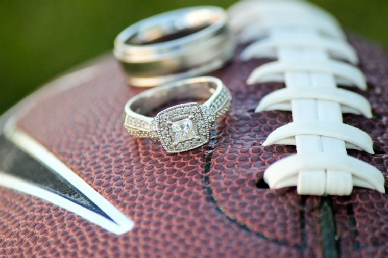 Wedding Rings on a Football Wedding Photography Raft Media Boise