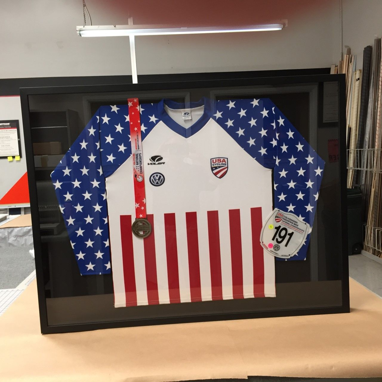 Patriotic #cycling #jersey and medal in #shadowbox using #LarsonJuhl ...