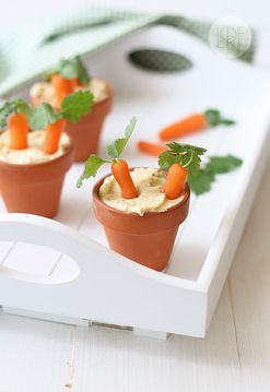 """Hummus w/ Roasted Garlic (serve hummus in small terracota pots with baby carrots. Just before serving, poke a hole in the top of each baby carrot with a toothpick and insert a sprig of cilantro or parsley into each hole. """"Plant"""" a couple of baby carrots in each pot, and enjoy!)"""