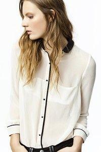 Blusa blanca juvenil con poca transparencia ideal para el trabajo