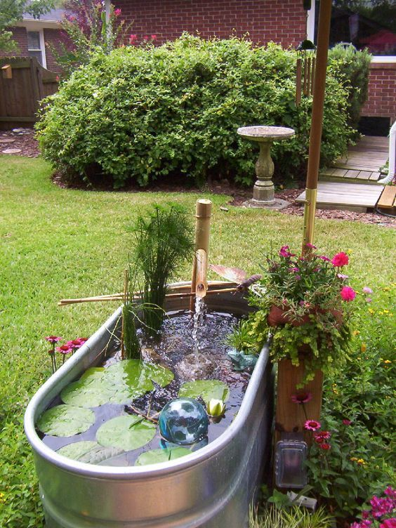 Galvanized Stock Tank Water Garden With Bamboo Pump Head