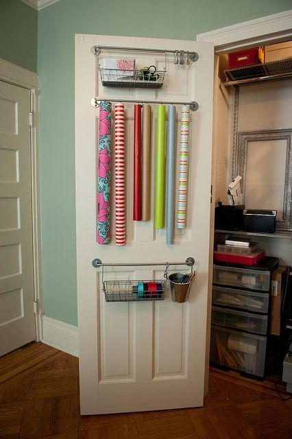 Wrapping storage on back of closet door.