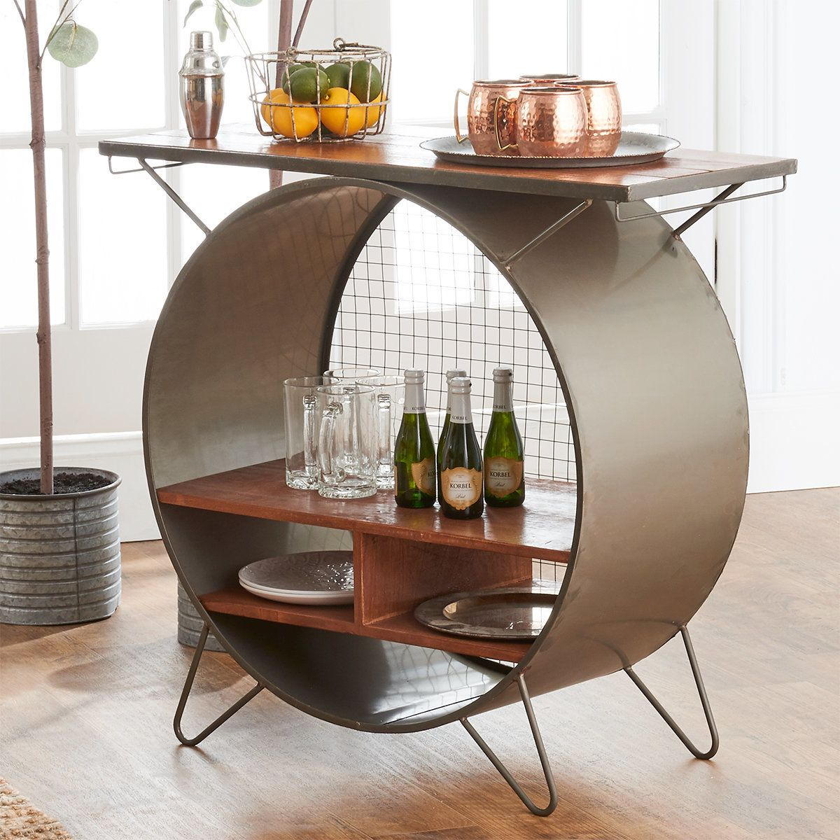 Understated charm stems from our Urban Bar Station Side Table.  This piece organizes, exudes personality, and sets the tone in your space.  From bar cart to entryway console, this piece has an industrial nature that will elevate your home.