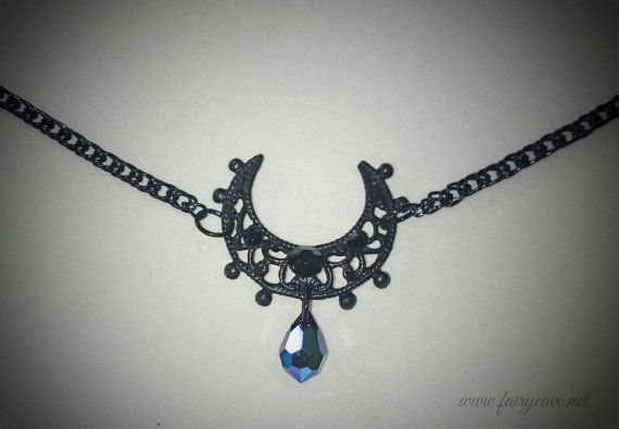 Tiara inspired by Sailor Moon. A delicate crescent moon in black color is held in the front with a thin segmented chain and a black teardrop falls