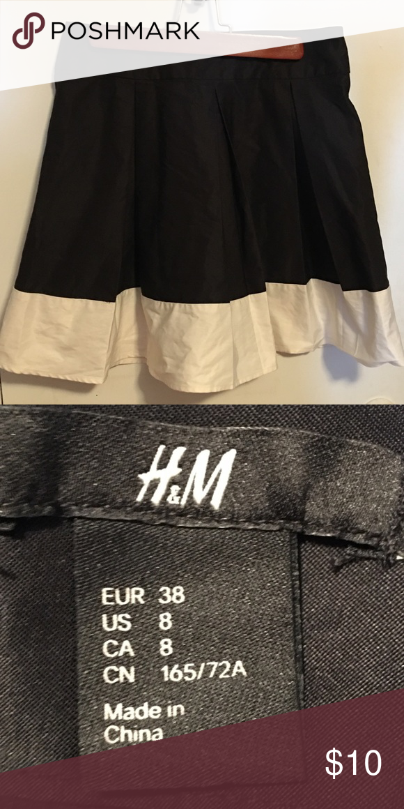 8ba3dd72e H&M pleated black and white skirt Pleated satin like black and white skirt  with zipper in the black. Excellent condition. Size 8 H&M Skirts