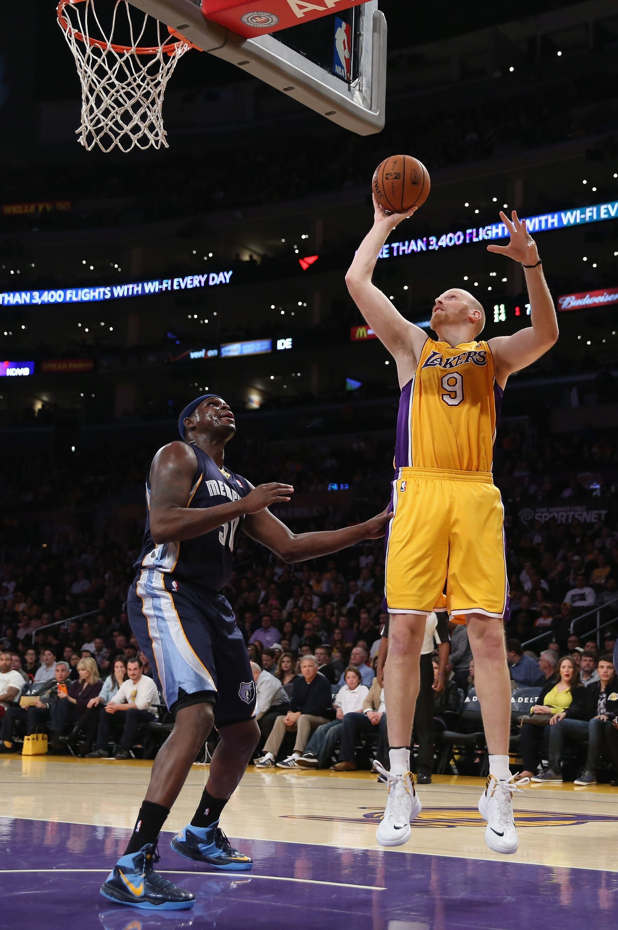 Los Angeles Ca November 15 Chris Kaman 9 Of The Los Angeles Lakers Shoots Over Zach Randolph 50 Of The M Memphis Grizzlies Los Angeles Lakers Los Angeles