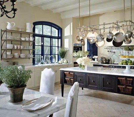Love all about this kitchen, open shelves, window w/ blue trim, island, pot racks on and on and on