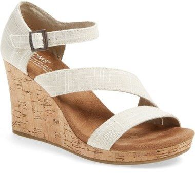 ad6ab7b892f TOMS  Clarissa  Wedge Sandal (Women) - Neutral straps woven from a  cotton-and-linen blend angle across a lightweight sandal lifted by a  natural cork woven ...