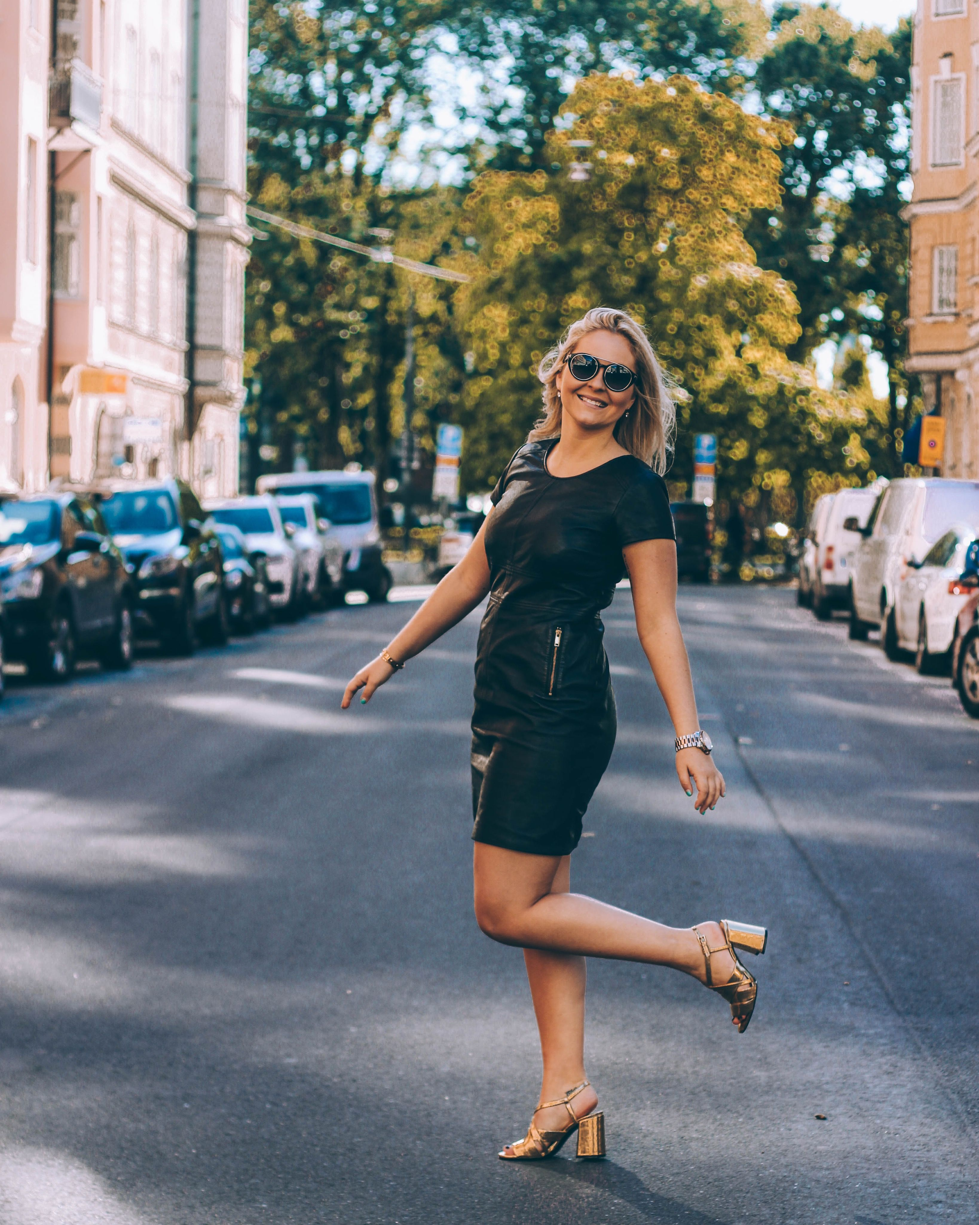Leather dress with golden shoes