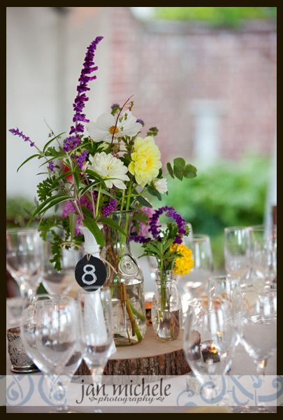 locally grown flowers on tables - River Farm Fall Garden wedding www.janmichele.com