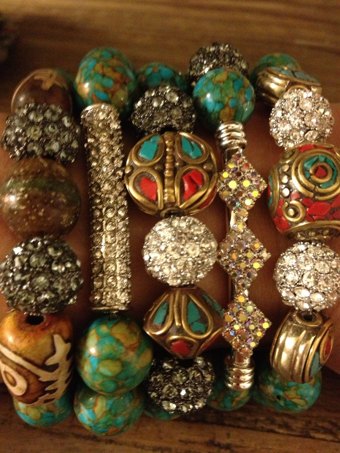 5 Bracelet stack with Large Turquoise and Tibetan  vintage beads and thunder crystal accents. $72.00, via Etsy.