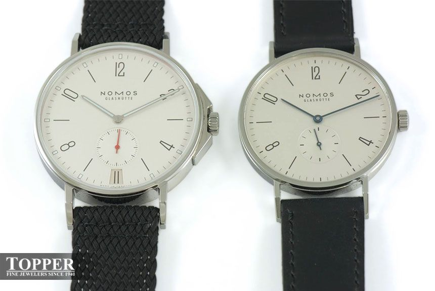 The Nomos Ahoi Datum (left) shown next to the thinner Tangente 38mm.