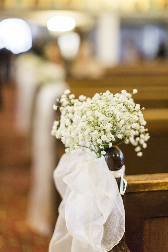 Gypsophila pew end with tulle bow for Church wedding decor for A Big Fat Greek Winter Wedding | I take you